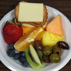 Crackers, cheeses, fruits, and olives
