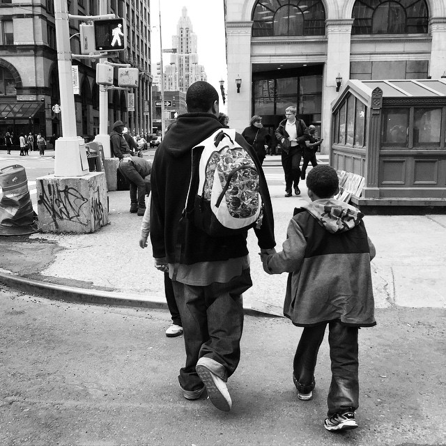Love is: carrying your kid's backpack and holding their hand to cross the street.   #loveis #nyc #greenwichvillage #eastvillage #loveit #gooddad #luckykid #observingstrangers