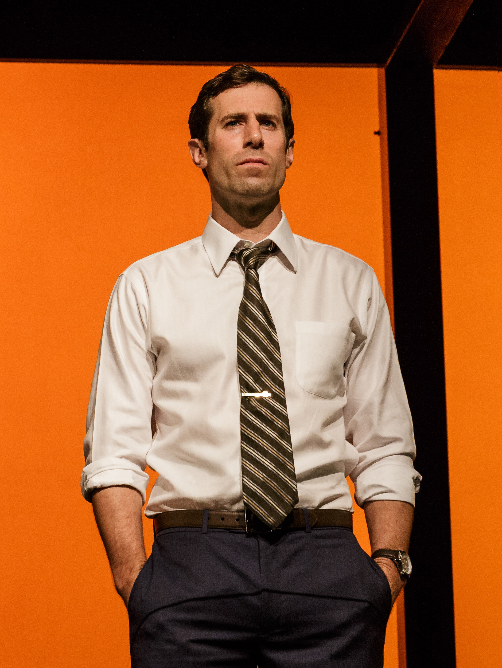 "Josh Cooke as ""Robert Merkin"" in La Jolla Playhouse's world premiere of JUNK: THE GOLDEN AGE OF DEBT, by Ayad Akhtar, directed by Doug Hughes, running in the Mandell Weiss Theatre July 26 – August 21; photo by Jim Carmody."