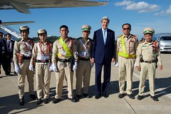 U.S. Secretary of State John Kerry poses for a photo with a group of Laotian traffic police before he departed from Wattay International Airport in Vientiane, Laos, on July 26, 2016, after he attended the annual meeting of the Association of Southeast Asian Nations (ASEAN). [State Department Photo/ Public Domain]