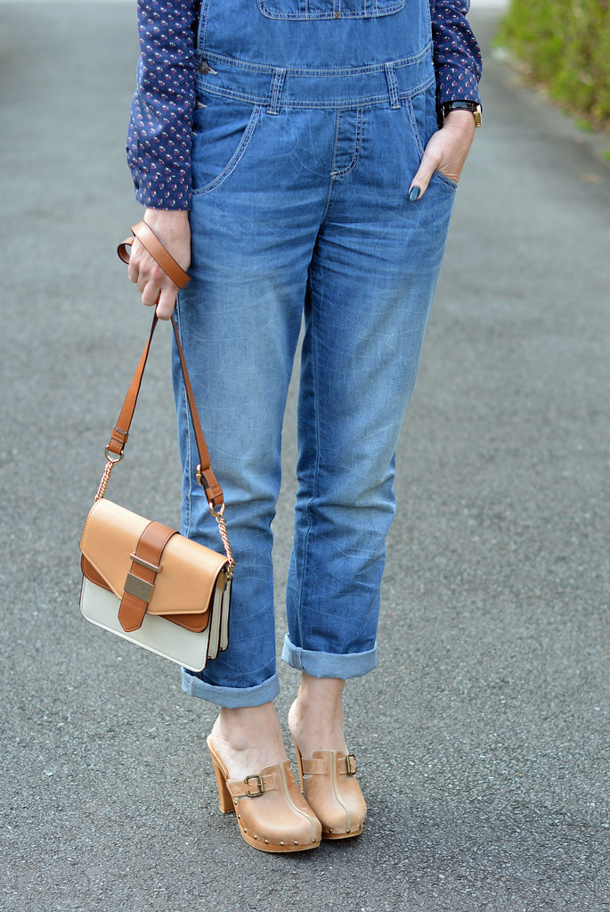 Blue denim dungarees (overalls), patterned shirt and heeled clogs