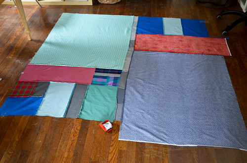 Step 1: Tape quilt backing to floor, right side down