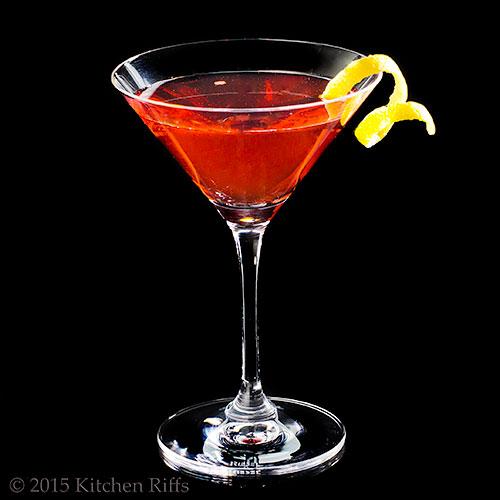 The Rosita Cocktail in cocktail glass with lemon twist garnish