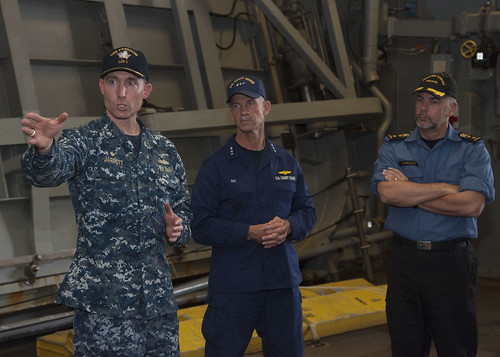SAN DIEGO - Cmdr. Michael Jarrett, commanding officer of the littoral combat ship USS Freedom (LCS 1), gives Vice Adm. Charles W. Ray, commander, U.S. Coast Guard Pacific and Royal Canadian Navy Rear Adm. William Truelove, commander, Maritime Forces Pacific a tour of Freedom's waterborne mission zone as part of Three-Party Staff Talks (TPST).