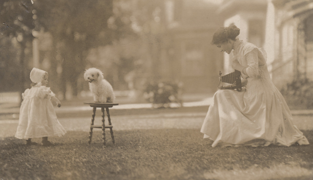 Florence Sallows photographing daughter and dog, date unknown