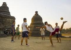 Men Playing Chinlone In Front Of Stupas, Mrauk U, Myanmar