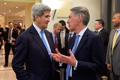 U.S. Secretary of State John Kerry chats with British Foreign Secretary Philip Hammond on March 29, 2015, in Lausanne, Switzerland, before a coordinating meeting among the P5+1 partner nations - the U.S., Germany, China, France, the United Kingdom, and Russia, as well as the European Union - about negotiations over the future of Iran's nuclear program. [State Department Photo / Public Domain]