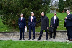 French Foreign Minister Laurent Fabius bids farewell to U.S. Secretary of State John Kerry and British Foreign Secretary Philip Hammond after the three ran across one another while taking walks on March 30, 2015, in Lausanne, Switzerland, during a break in negotiations with Iranian officials about the future of their country's nuclear program. [State Department photo/ Public Domain]