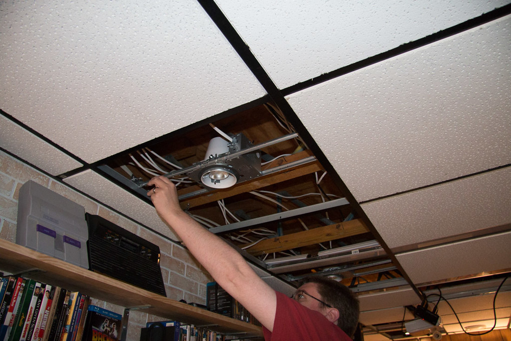 Putting cut ceiling tiles back in ceiling around recessed lighting housing