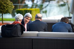 U.S. Secretary of State John Kerry chats with three advisers - Under Secretary of State for Political Affairs Wendy Sherman, National Security Council Senior Director for Iran, Iraq, Syria and the Gulf States Robert Malley, and Chief of Staff Jon Finer, in Lausanne, Switzerland, on March 27, 2015, amid a break in negotiations with Iranian leaders about the future of their nuclear program. [State Department photo/ Public Domain]