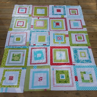 New and improved #redandaquabee quilt with 4×5 block layout for a growing (almost) four year old. Block placement to be refined at this weekend's @vancouvermqg sew-in. Thanks to all four grandparents for watching the girls over spring break so I could sew