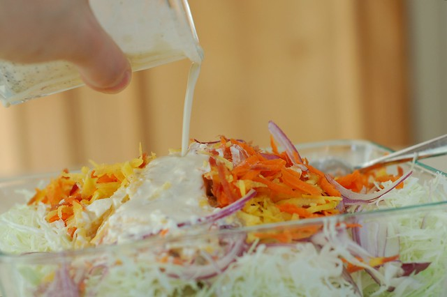Dressing the confetti coleslaw by Eve Fox, the Garden of Eating, copyright 2015