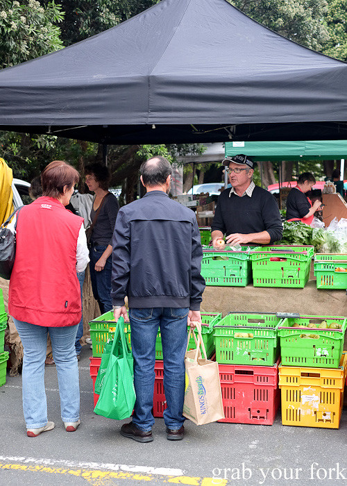 Stallholder chatting with local shoppers at Thorndon Farmers' Market, Wellington