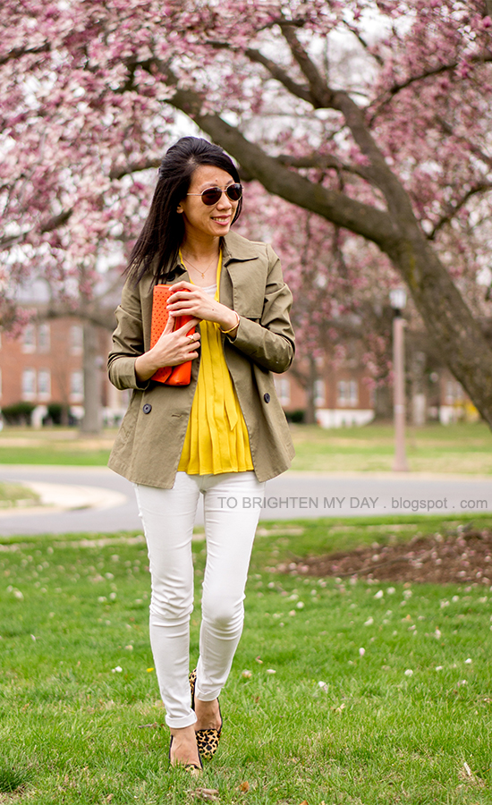 green swing jacket, mustard pleated top, white jeans, orange clutch, leopard flats