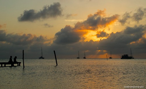 ocean light sunset sea nature water clouds sailboat landscape island dock belize mooring caye caribbean rays silohuette caulker