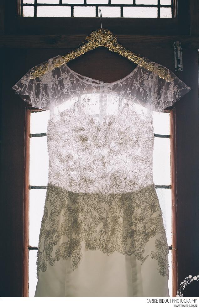 Elli-Nicole Lace wedding dress on a glitter gold sequin hanger from weddinghangers.co.za