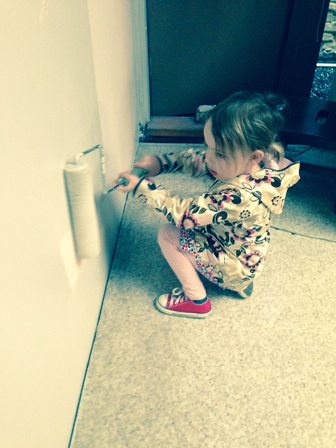 helping daddy paint the wall