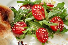 salad with tomatoes, arugula and sesame