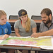 Students Dani Orrell (left), Alannah Gonzalez and Jorge A. Gonzalez discuss their Geological Field Method assignment.