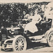 Small photo of Family in driving goggles rides in a car