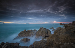 muzzpix-nz posted a photo:Facebook      500px    WebsiteThe centuries old rhyolite lava rocks at the Mount make for tricky access with a photog back-pack and tripod at low tide . Not a good place to trip and fall ... would not be pretty . But sure makes for a dramatic shore-line .