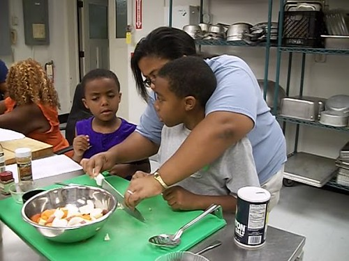 """Maine 4-H learn some knife skills as part of the University of Maine's """"iCook"""" program.  Four other states are joining Maine in this childhood obesity prevention program. (Courtesy photo from Maine 4-H)"""