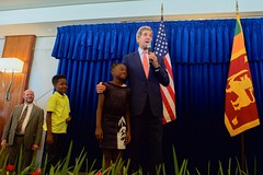 U.S. Secretary of State John Kerry embraces a child as he addresses employees and family members from U.S. Embassy Sri Lanka on May 3, 2015, in Colombo, Sri Lanka, while paying the first official visit to the island-nation by someone in his office in 43 years. [State Department Photo/Public Domain]
