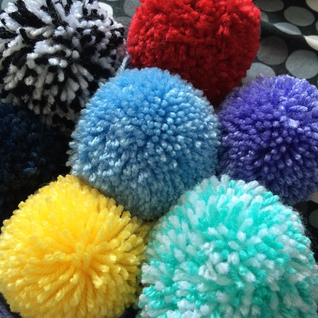 Making pom-poms! I think I've got the hang of it now.