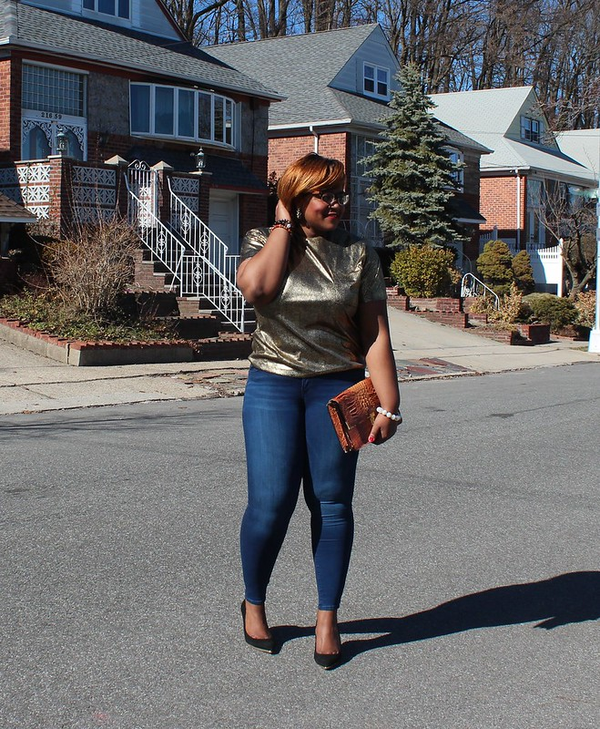 metallic gold top and stretch jeans
