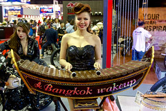 Sexy model playing a ระนาดเอก (Ranat ek) at the 36th Bangkok International Motor Show