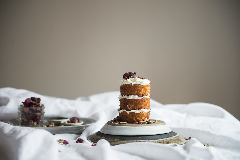 almond cake with rose mascarpone frosting | two red bowls