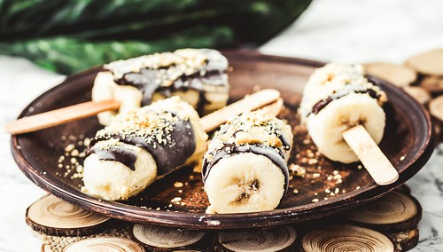 Frozen bananas with chocolate and nuts, raw summer dessert