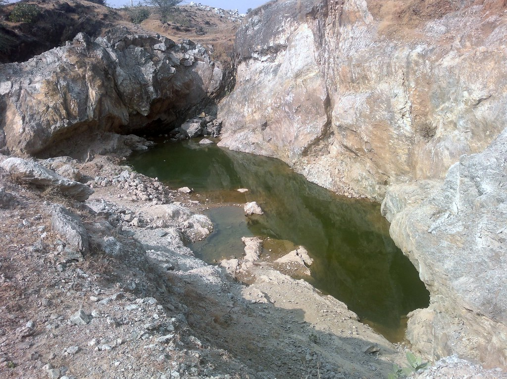 Government has given mining leases on the land. One of the mine breached the water table in the area.