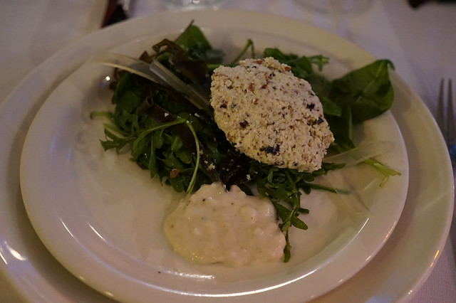 "Almond and seaweed ""gefilte fish"" with horseradish mousse on sautéed bitter greens"