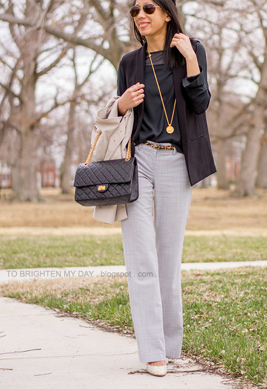 black vest + top, leopard belt, gray pants