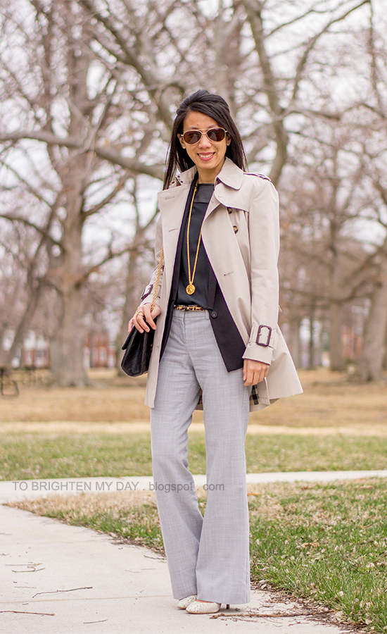 trench coat, black vest + top, leopard belt, gray pants