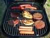 Burgers, Hot Dogs And Chicken On The Grill.