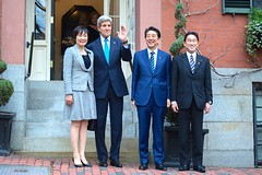 U.S. Secretary of State John Kerry poses with Japanese Prime Minister Shinzo Abe and his wife, Akie Abe, as well as Japanese Foreign Minister Fumio Kishida, in front of his home on Beacon Hill in Boston, Massachusetts, on April 26, 2015, before a working dinner at the outset of the Abes' weeklong State visit to the United States. [State Department photo/ Public Domain]