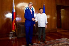 U.S. Secretary of State John Kerry and Philippines President Rodrigo Duterte pose for photographers on July 27, 2016, in the Malacañang Palace in Manila, Philippines, before the two held a working lunch. [State Department Photo/Public Domain]