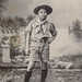 Small photo of Asian American boy scout stands in a studio