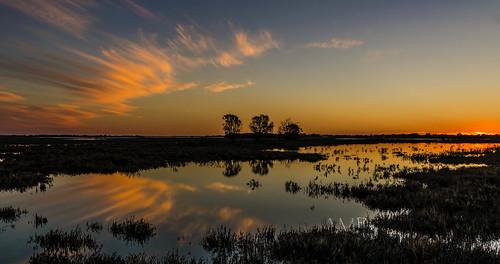 sunset water clouds wetlands peel mandurah