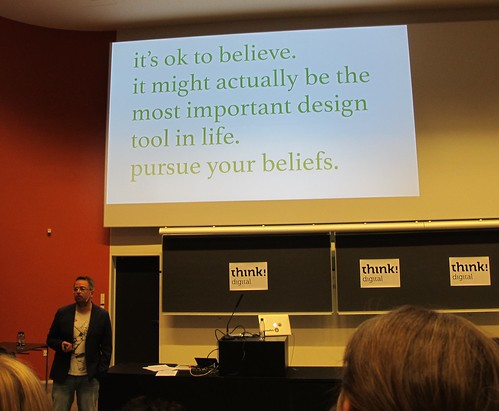 Thomas Madsen-Mygdal in front of his slide with the quote about believing at UX Camp CPH 2015