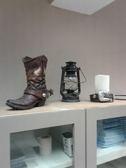 Boot, lantern & belt around a candle.