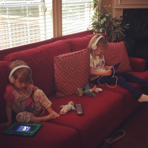 Trying to keep the girls quiet while my sister is on conference calls this morning. iPads & headphones are pretty much the best thing ever.