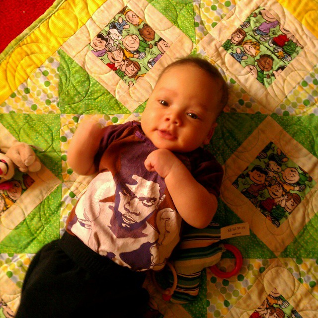 Baby D enjoying a beautiful handmade gift from a quilter friend - a polka dot Peanuts quilt (we both used to work for the company that licensed Peanuts) . Little dude is wearing a #memade Basquiat onesie upcycled from his Daddy's T-shirt.