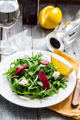 Fresh green salad with beets, goat cheese and oliv…