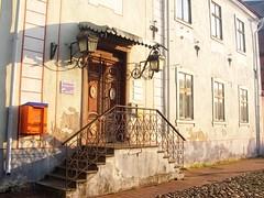 Graceful old building with orange mailbox in Pärnu, Estonia