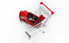 model car(1.0), vehicle(1.0), red(1.0), scale model(1.0), shopping cart(1.0),