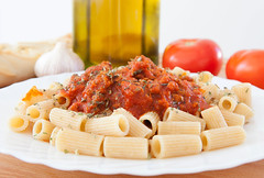Delicious plate of macaroni with tomato
