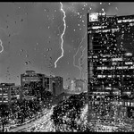 21. August 2015 - 1:03 - Several closeby strikes recorded in separate exposures, stacked and blended in PS, and returned to LR for final. When the intense flash struck the antenna on the building about a block away, I was blinded by the flash and could feel the heat, it was that powerful.  I had no idea what the camera captured, of course, until I looked.  I was pleasantly surprised that it wasn't washed out, which was largely attributable to small f-stop and very low ISO setting.